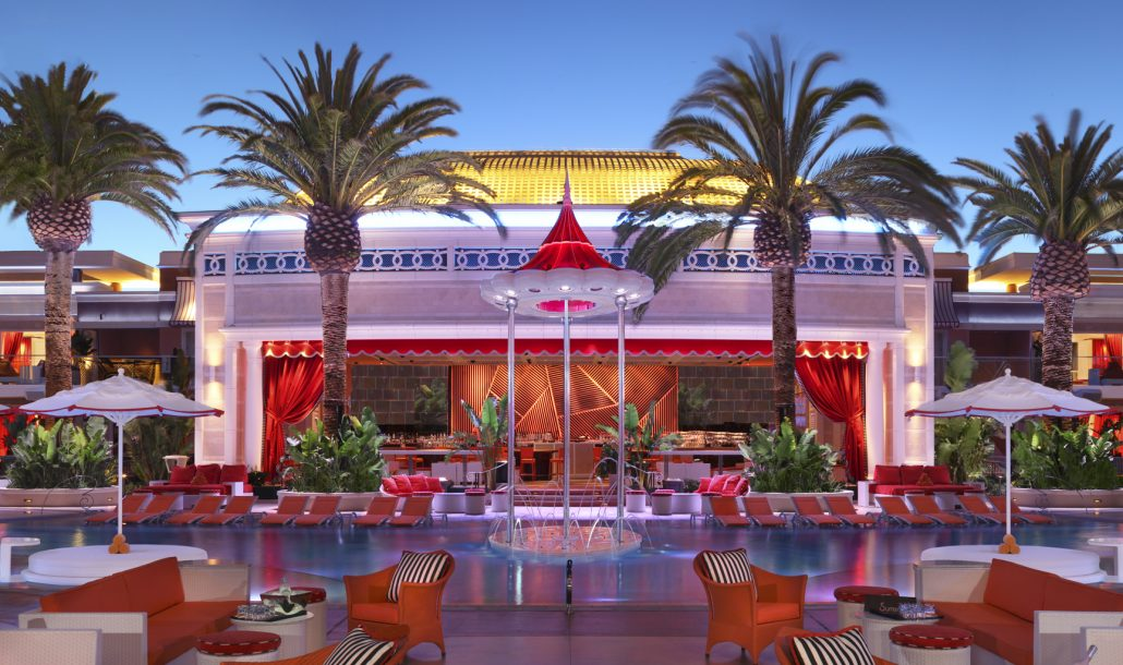 Encore Beach Club pool at sunset