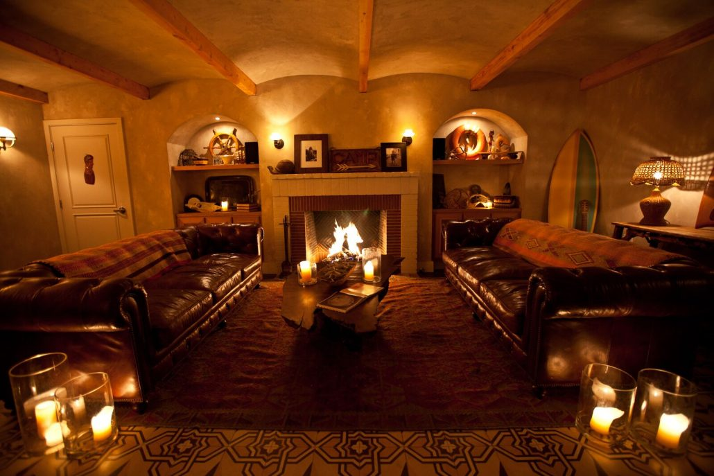 the bungalow santa monica lounge indoor seating by fireplace