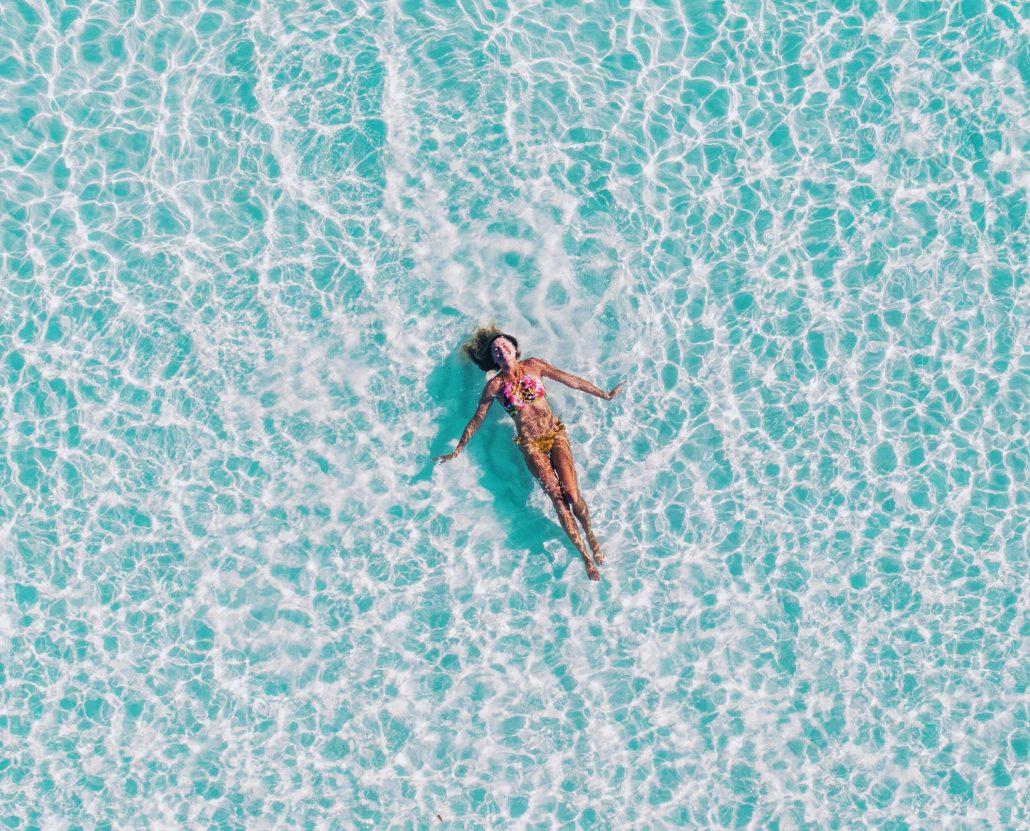 girl in ocean floating