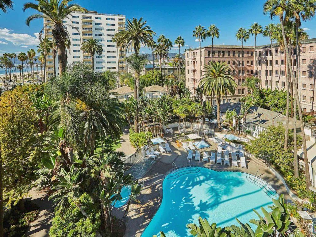 fairmont miramar pool with palm trees