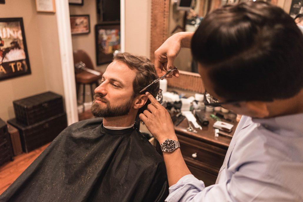 guy getting haircut at lloyds barbershop at fairmont santa monica