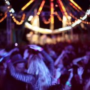 people dancing at neon carnival