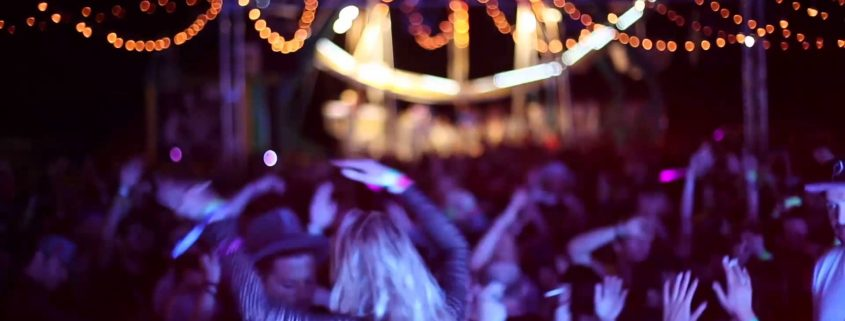 people dancing at neon carnival
