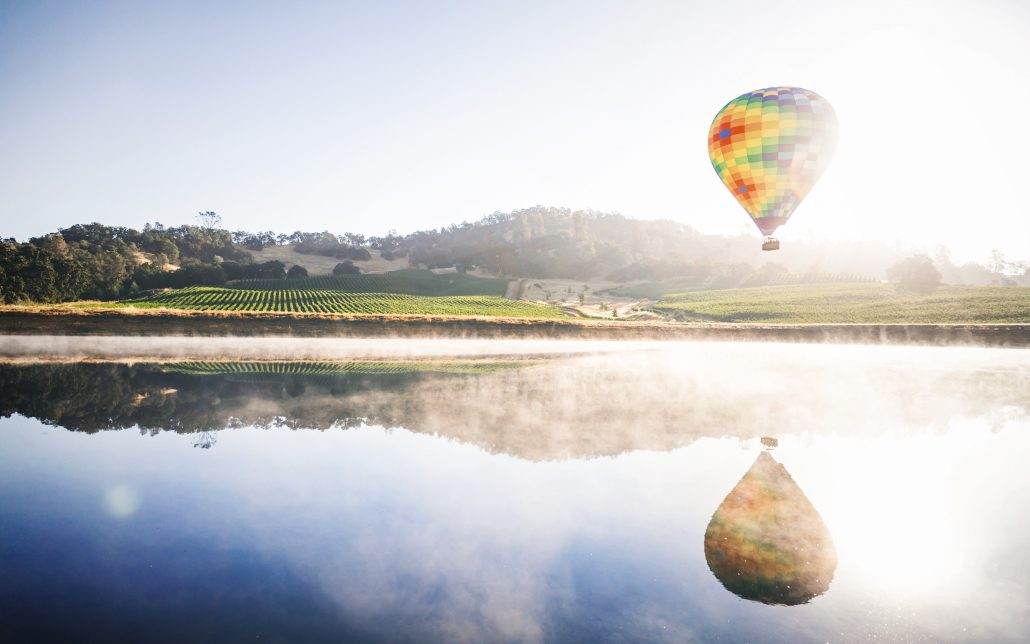 hot air balloon over water in napa