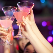 girls celebrating cheers drinks