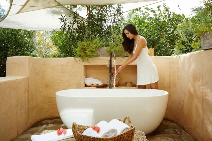 girl by bathtub spa retreat