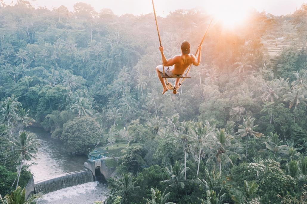 guy swinging in bali ubud