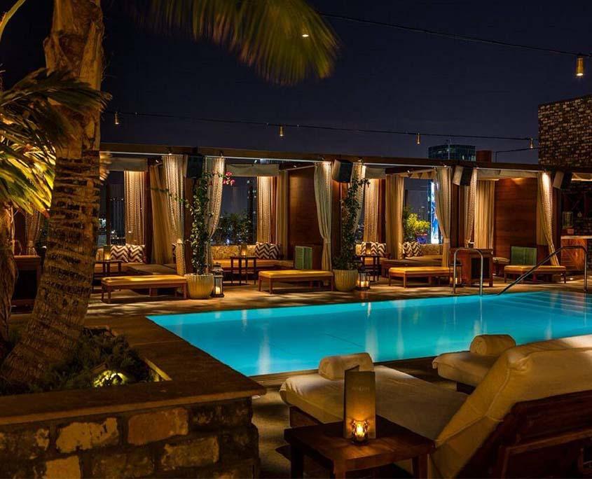 highlight room pool and cabanas at night
