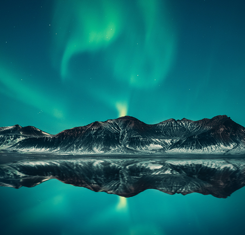 northern lights reflection over water iceland