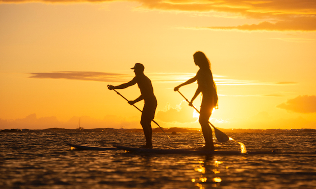 couple paddleboard in the ocean