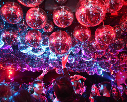 sunset at edition disco balls and dancing