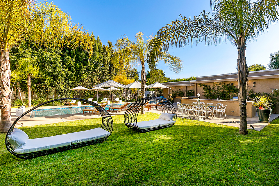 beverly hills villa rental lounge chairs on grass