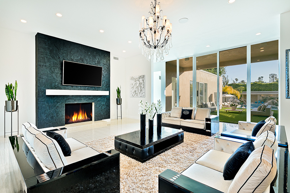 beverly hills villa rental family room with fireplace
