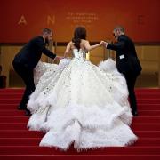girl wearing dress red carpet cannes film festival