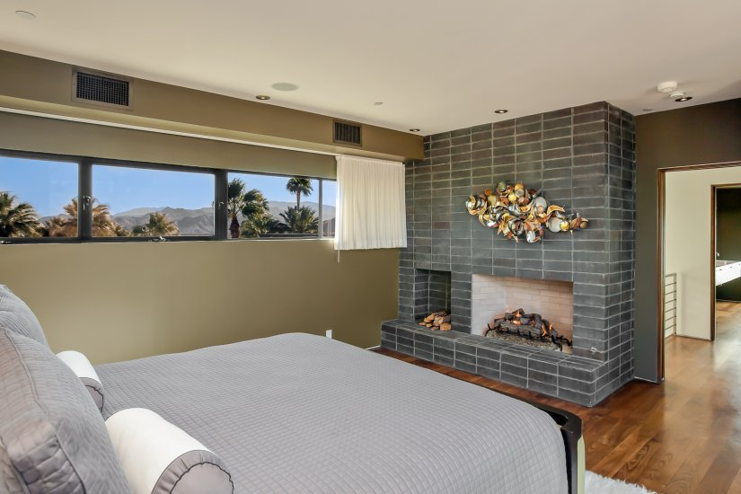 palm springs villa rental guest bedroom with fireplace
