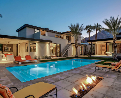 palm springs villa rental pool at night with firepit