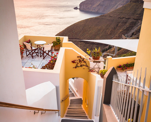 stairs overlooking cliffs and ocean in greece