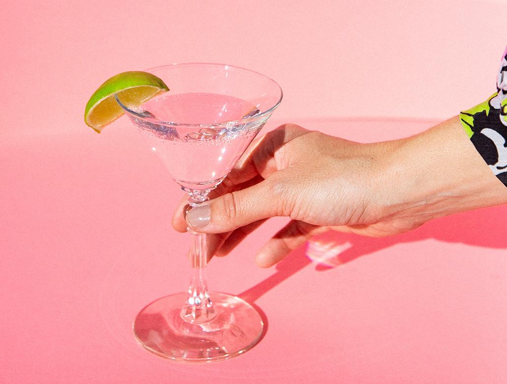 girl drinking martini in palm springs