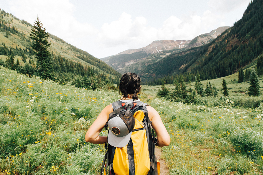 girl hiking with backpack outdoor travel